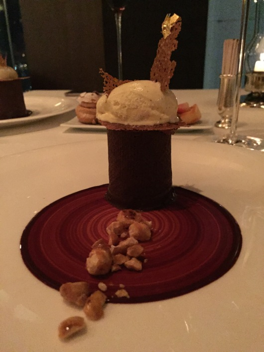 Amadei Toscano chocolate light mousse with caramelized hazelnuts and Madagascar vanilla ice cream.